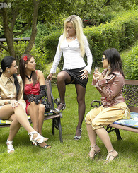 Four very hot clothed teenage lesbians fucking outdoors